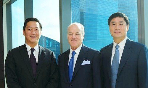 Left to right, Joseph Bae, Henry Kravis, and Ming Lu